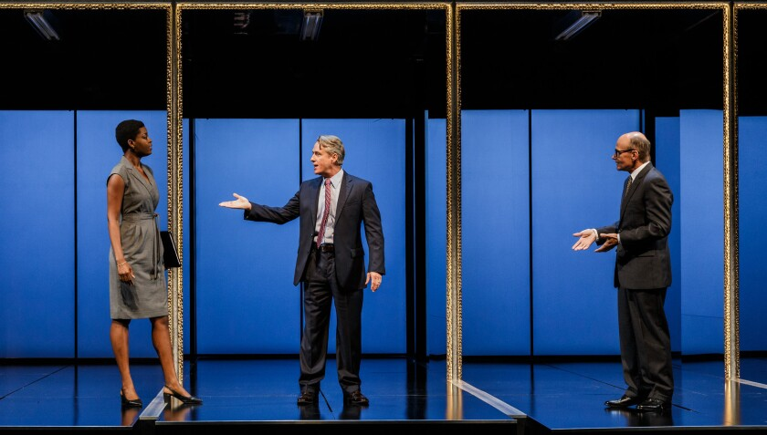 """Zakiya Iman Markland, Linus Roache and Henry Stram (from left) in La Jolla Playhouse's 2016 world-premiere production of """"Junk: The Golden Age of Debt."""""""