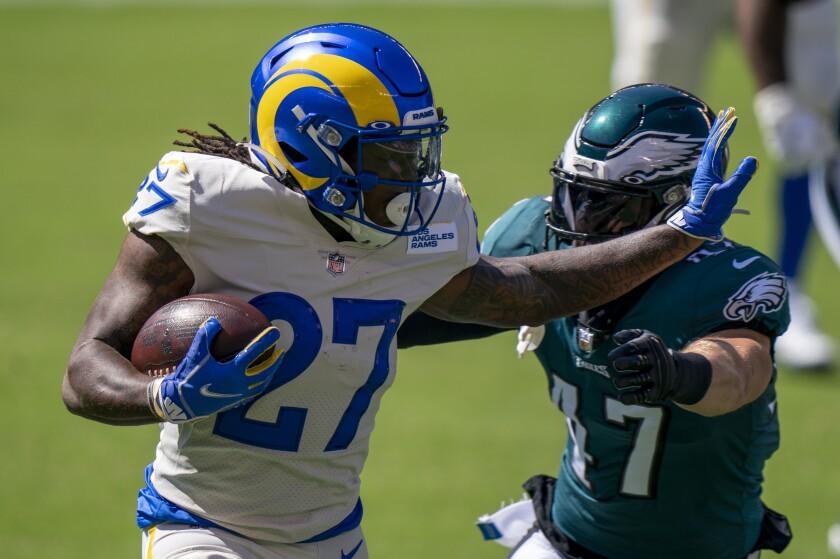 Rams running back Darrell Henderson, left, tries to fend off Philadelphia Eagles linebacker Nate Gerry.