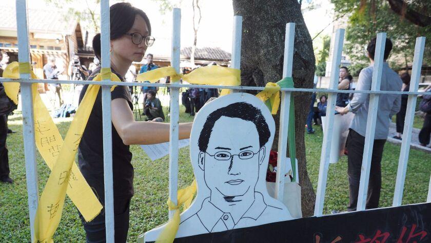 Taiwanese tie yellow ribbons for Taiwan human rights activist Li Ming-che, Taipei - 28 Nov 2017