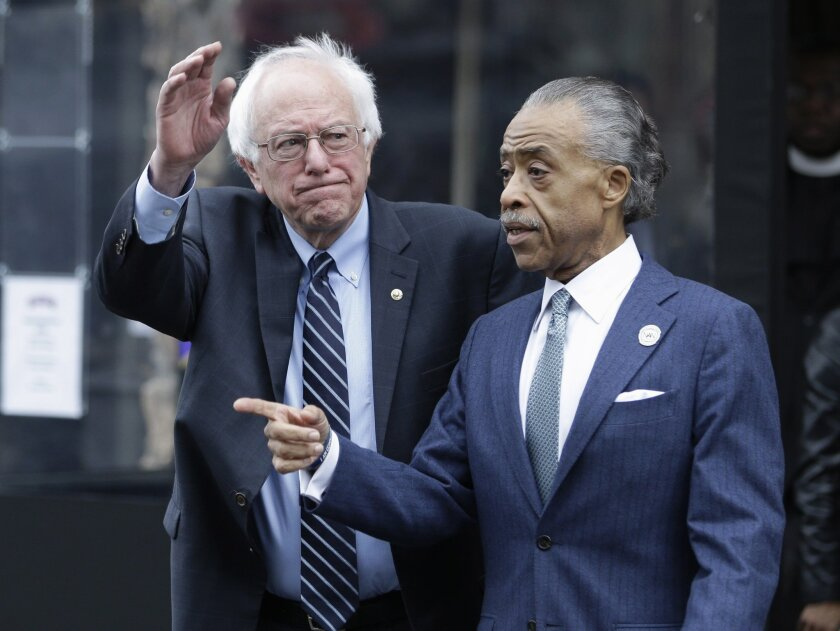 Democratic presidential candidate Sen. Bernie Sanders of Vermont waves to media and supporters after a breakfast meeting with the Rev. Al Sharpton at Sylvia's Restaurant in New York's Harlem.