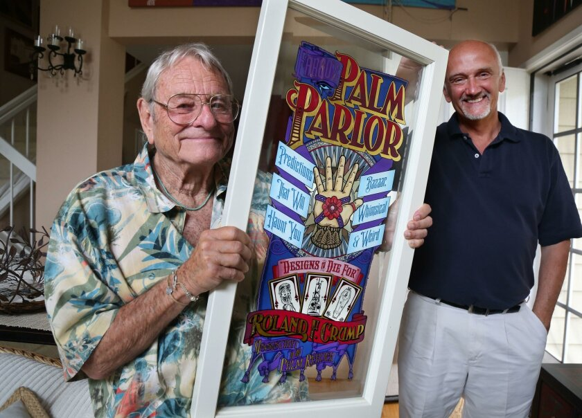 "Carlsbad resident Rolly Crump, left, holds a replica of the window featuring his name on Main Street at Disneyland. Ken Kebow, right, of Vista made a film about Crump's life, ""The Whimsical Imagineer,"" which screens Aug. 11 at the Oceanside International Film Festival."
