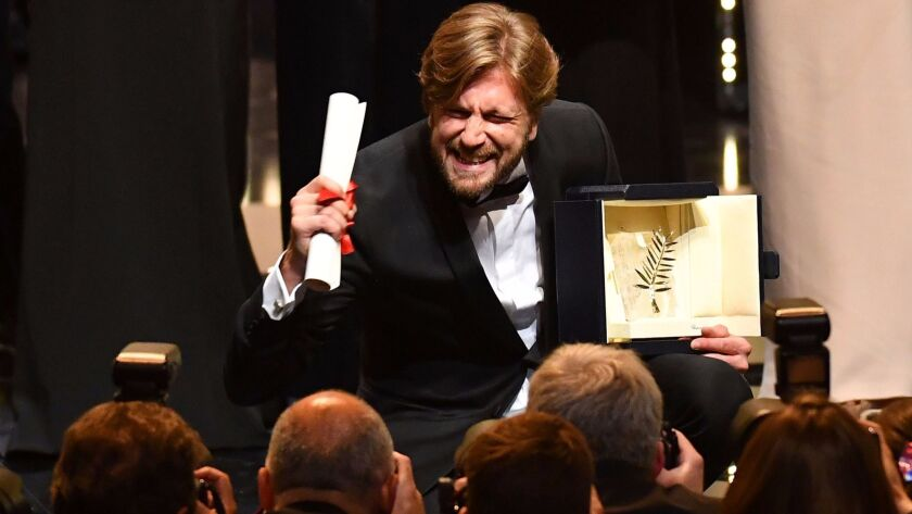 Swedish director Ruben Östlund poses on stage after he was awarded the Palme d'Or for the film 'The Square' at the Cannes Film Festival.