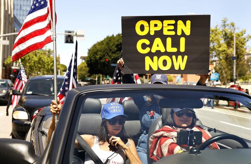 Alma Villanueva, left, and Gigi Wilcox   protest