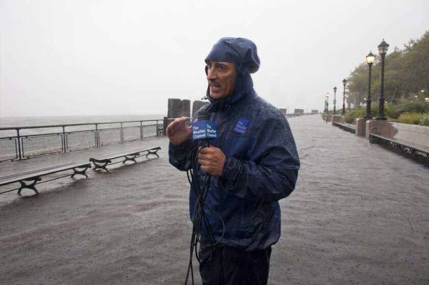 Jim Cantore delivers a report on the Weather Channel.