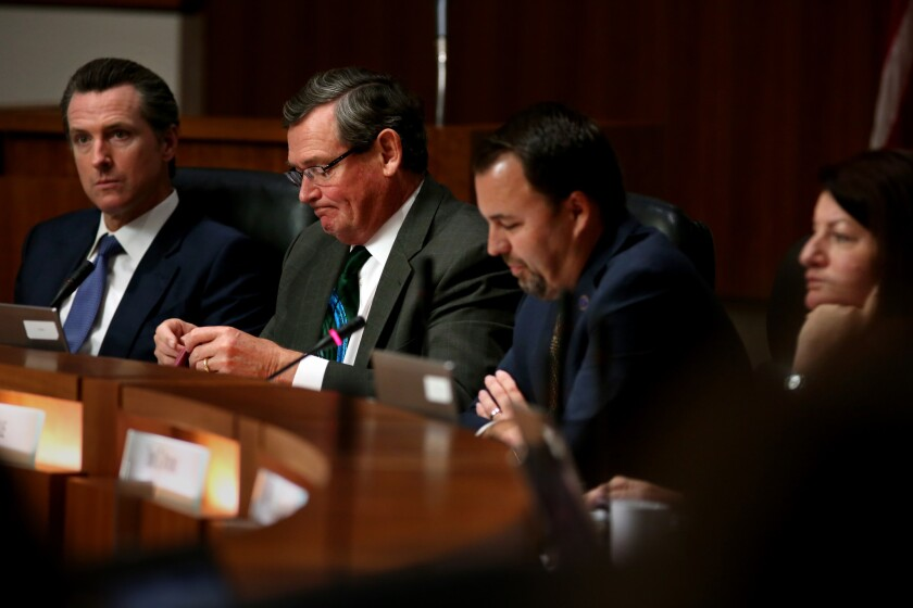 Cal State trustees in a meeting