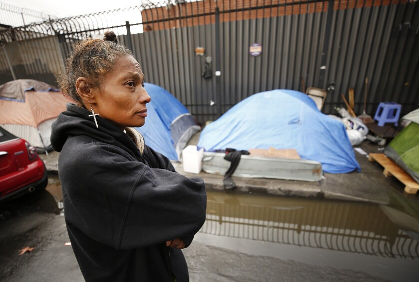 Margaret Wiley outside her tent on skid row