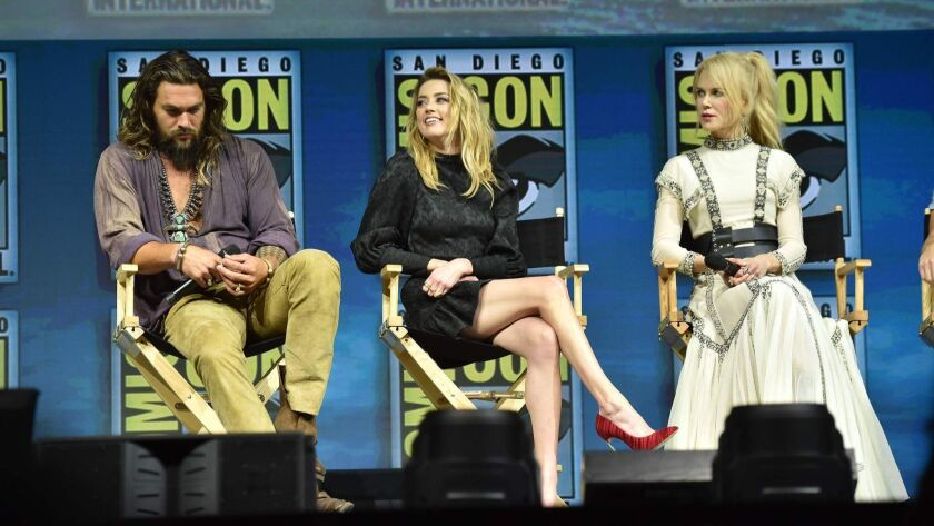 "Jason Momoa, left, Amber Heard and Nicole Kidman in the Comic-Con panel for ""Aquaman."""