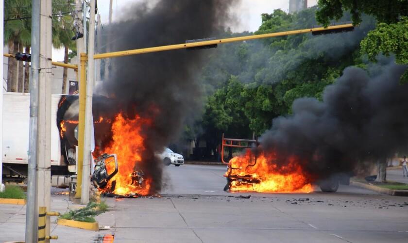 Trucks burn on a street in Culiacan