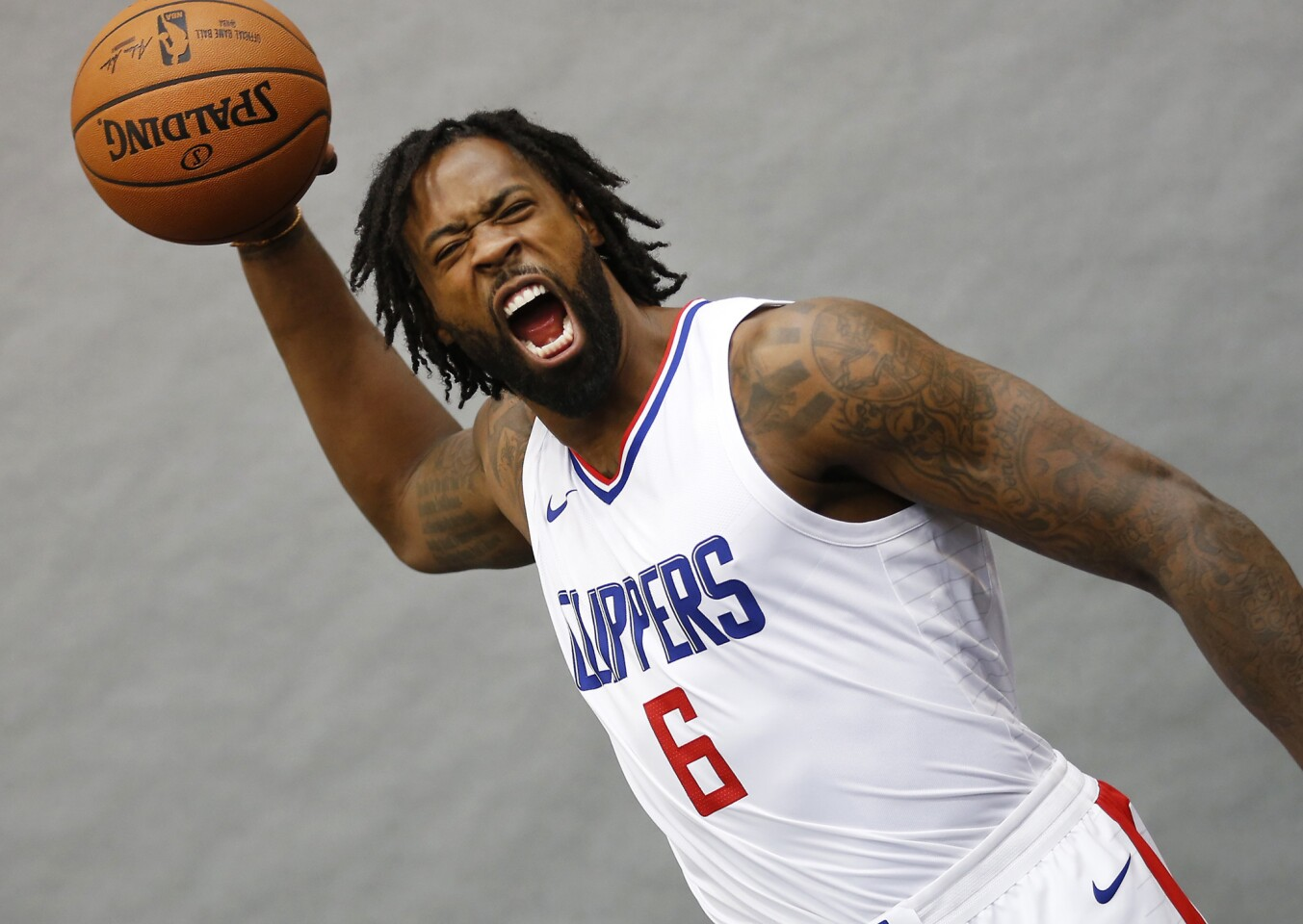 Clippers centers DeAndre Jordan screams during Clippers media day at the team's training center in Playa Vista on Sept. 25.