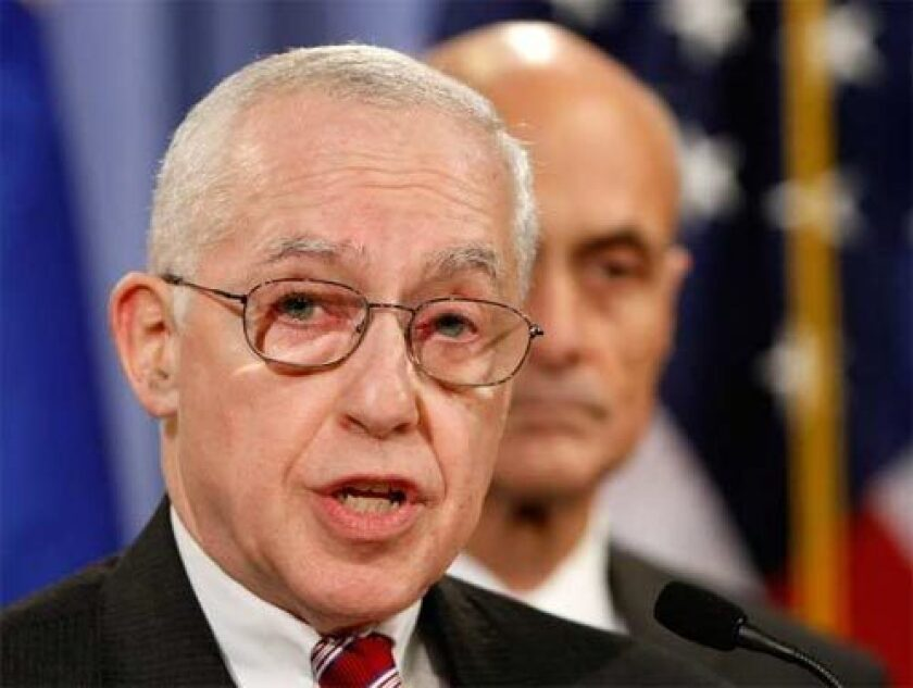 DECEMBER 11: Attorney General Michael Mukasey, left, answers questions about the CIA's destruction of interrogation videotapes with Homeland Security Secretary Michael Chertoff, right, at the Justice Department in Washington, DC.