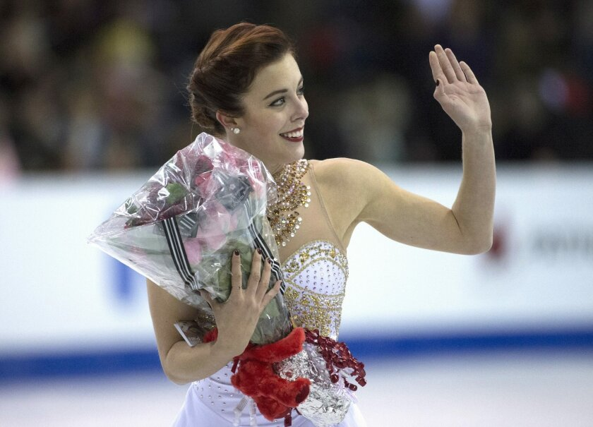 Ashley Wagner, of the United States, waves to the crowd following the ladies free skate at Skate Canada International in Lethbridge, Alberta., Saturday, Oct. 31, 2015. (Jonathan Hayward/The Canadian Press via AP)
