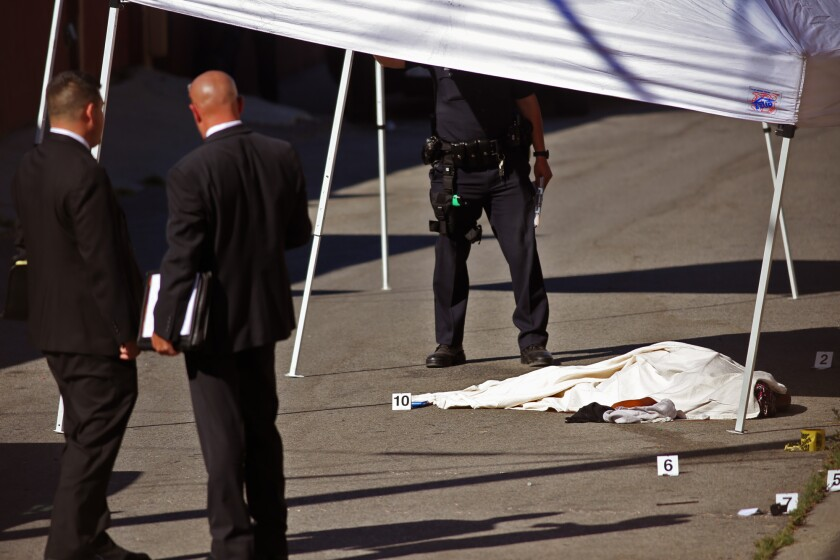 Authorities at the scene where a woman was shot during a confrontation with police in an alley in Baldwin Hills.