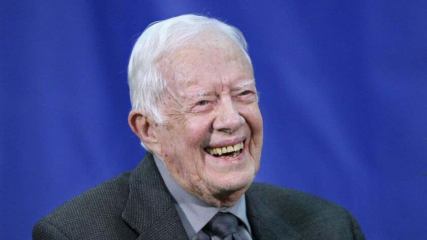 FILE- In this Sept. 12, 2018, file photo former President Jimmy Carter answers questions from studen