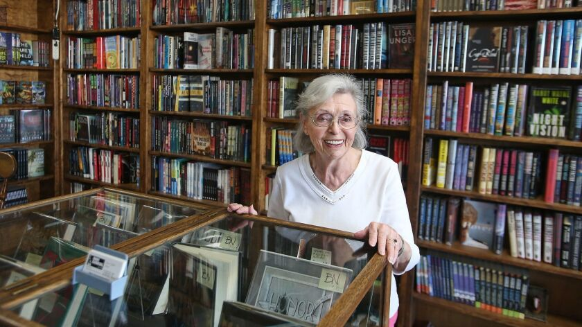 Owner Anne Saller proudly stands in the front room of Book Carnival, where she hosts a book club to