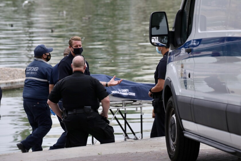An investigation is underway after a body was found in the lake at MacArthur Park Friday morning.