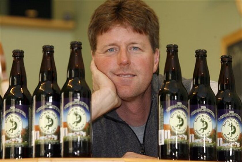 """Matt Nadeau poses at Rock Art Brewery in Morrisville, Vt., Monday, Oct. 12, 2009. The Vermont brewery that sells a beer called """"Vermonster"""" has been told by Hansen Beverage Co., the maker of Monster energy drinks, to stop selling the brew. (AP Photo/Toby Talbot)"""