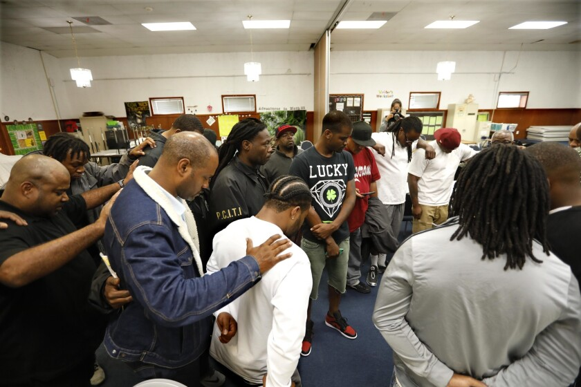 Gang leaders bow in prayer to conclude the peace summit. Like the truces of the early 1990s, the current peace movement appears to be largely confined to L.A.-area black gangs.
