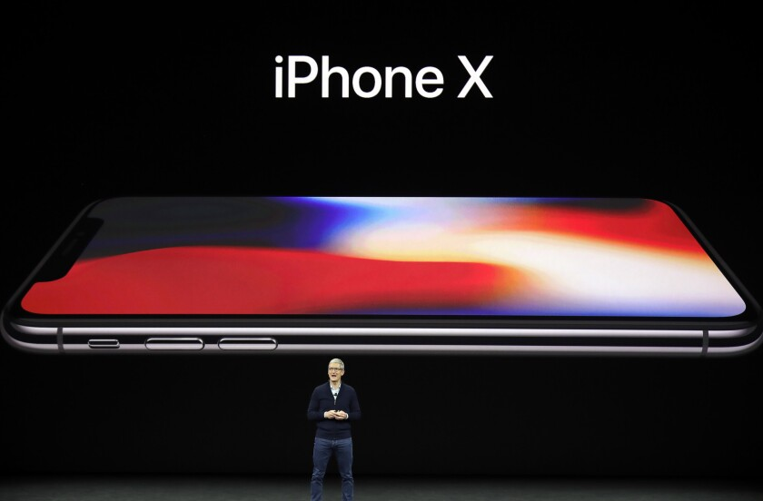 Apple CEO Tim Cook announces the iPhone X in 2017.