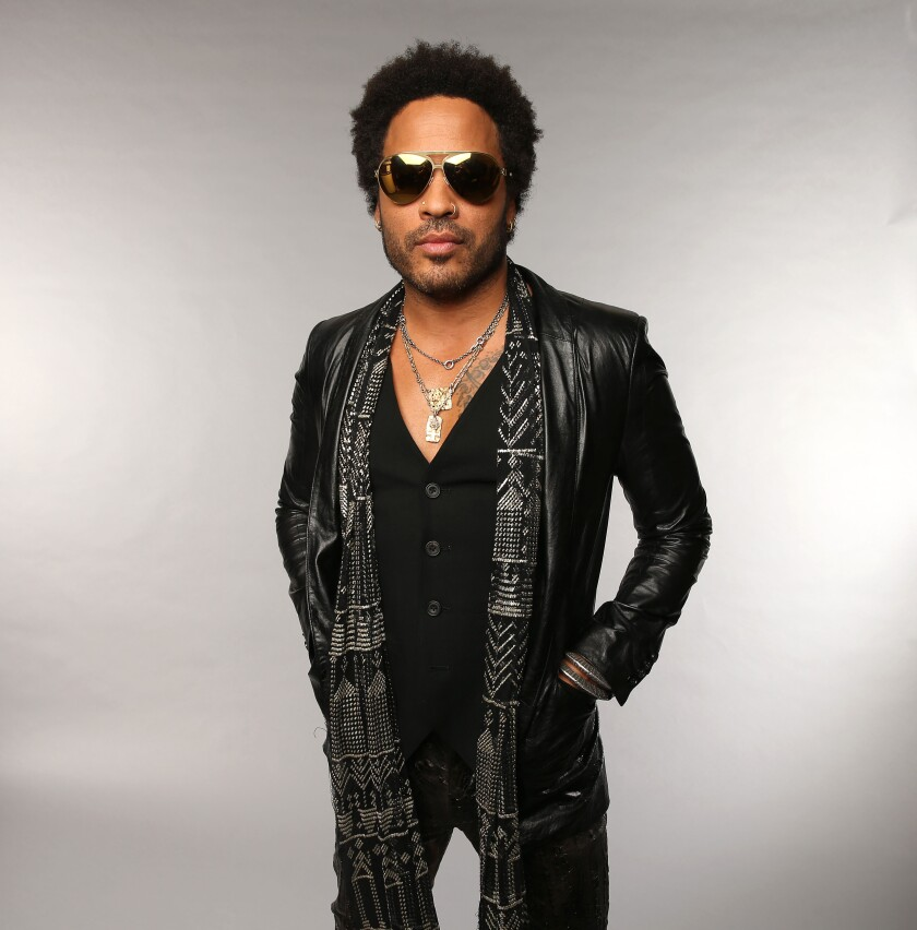 A photo of Lenny Kravitz at the Wonderwall Portrait Studio for the 2013 CMT Music Awards