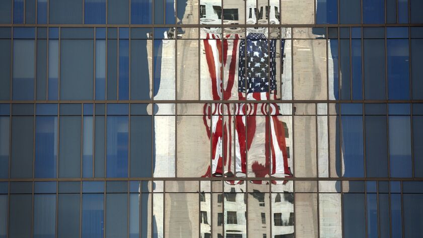 L.A. City Hall is reflected in the windows of the Los Angeles Police Department headquarters building downtown.