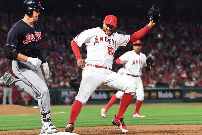 ANAHEIM, CALIFORNIA APRIL 2, 2018-Indians batter Bradley Zimmer beats Angels pitcher J.C. Ramirez to