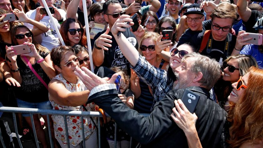 Mark Hamill poses for photos with adoring fans at the dedication of Mark Hamill Drive.