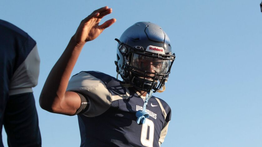 Madison quarterback Terrell Carter was 10 of 12 for 261 yards and five touchdowns in the Warhawks' win over Point Loma.