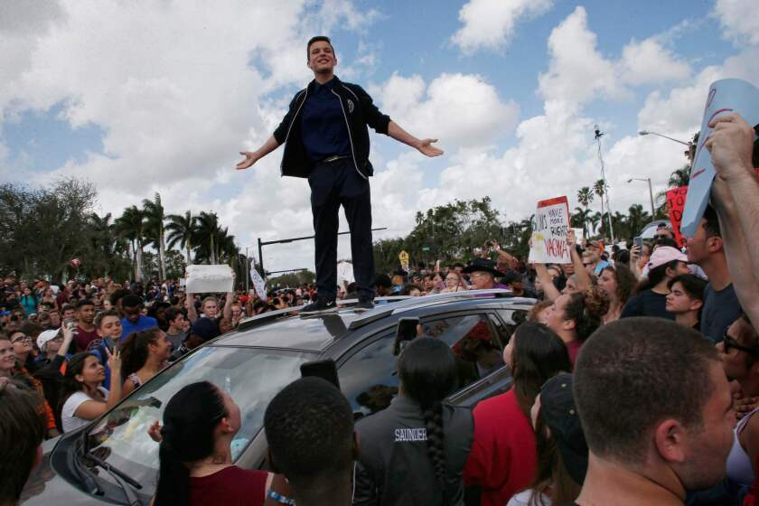 Majory Stoneman High School student Cameron Kasky addresses students as they rally at the school after participating in a walkout in Parkland, Fla. on Feb. 21, 2018.