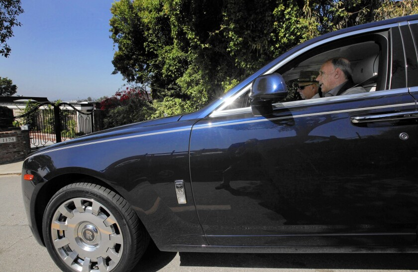 Jeff Hyland, a high-end real estate agent in Beverly Hills, gives columnist Steve Lopez a tour in his Rolls-Royce of some of the area's pricier properties.