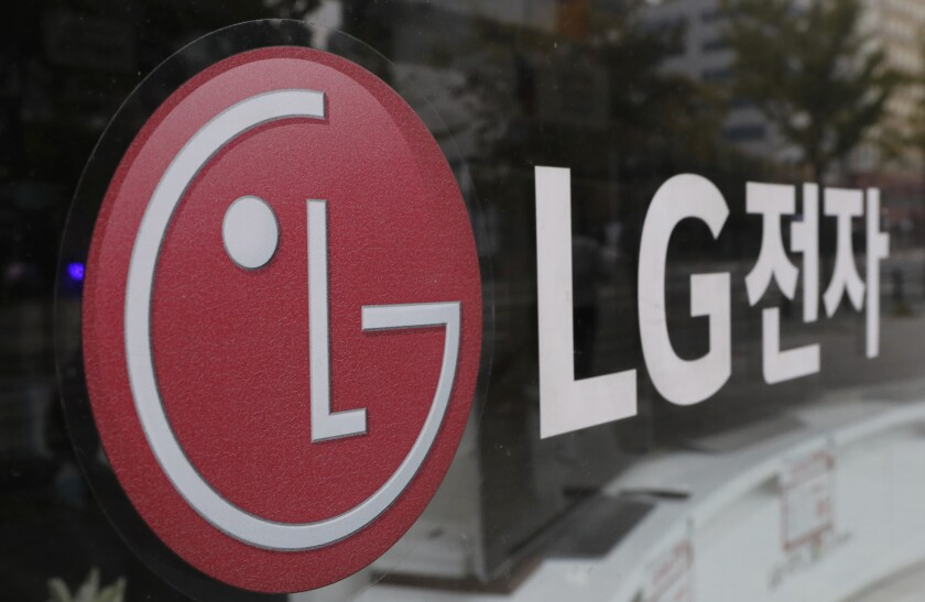 FILE - This Oct. 26, 2017 file photo shows the corporate logo of LG Electronics in Goyang, South Korea. Two South Korean electric vehicle battery makers have settled a long-running trade dispute that will allow one of them to move ahead with plans to make batteries in Georgia. That's according to a person briefed on the matter. The person says LG Energy Solution and SK Innovation reached the settlement, ending the need for President Joe Biden to intervene.(AP Photo/Lee Jin-man, File)