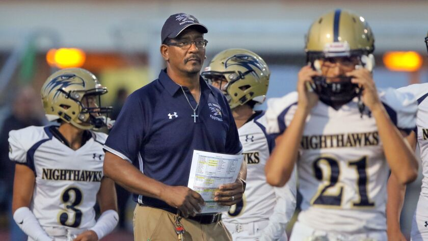 Del Norte High Coach Leigh Cole with his team before the game.