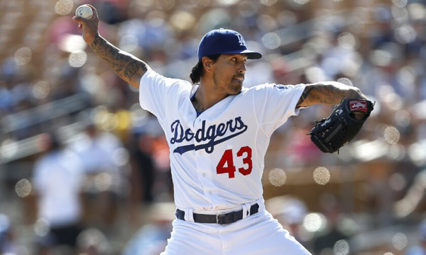 Dodgers pitcher Brandon League throws during an exhibition game against the Texas Rangers on Friday. The reliever struggled in Monday's 8-8 Cactus League tie with the Oakland Athletics.