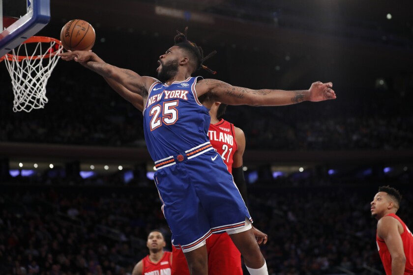 Portland Trail Blazers center Hassan Whiteside (21) interrupts a shot by New York Knicks guard Reggie Bullock (25) during the second half of an NBA basketball game in New York, Wednesday, Jan. 1, 2020. (AP Photo/Kathy Willens)