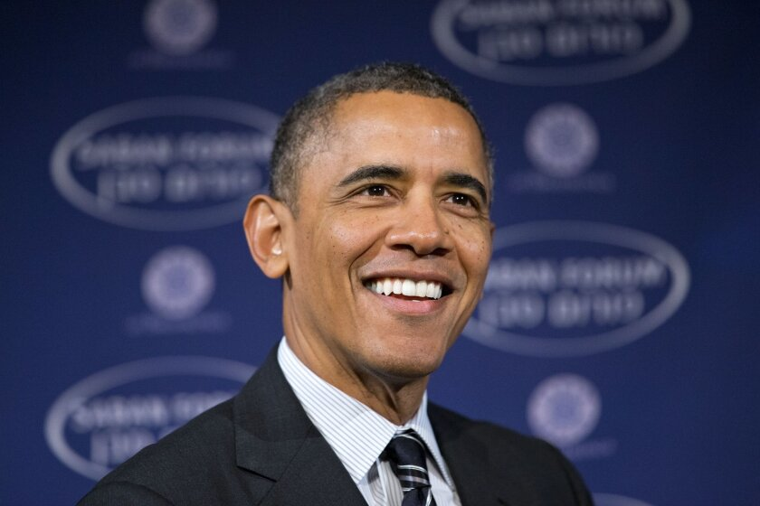 President Barack Obama smiles as he arrives at the Saban Forum to speak about the Middle East at the Willard Hotel in Washington, Saturday, Dec. 7, 2013. The 2013 Forum is examining the political changes taking place across the Middle East, and the President spoke about topics including Iran. (AP Photo/Jacquelyn Martin)