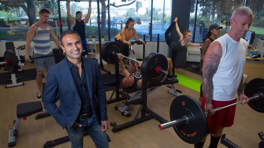 At their office in Kearny Mesa, Munjal Shah, CEO of SD-based Health IQ shows off gym equipment that the company leaves out on the main office floor for employees to exercise during the normal work day.