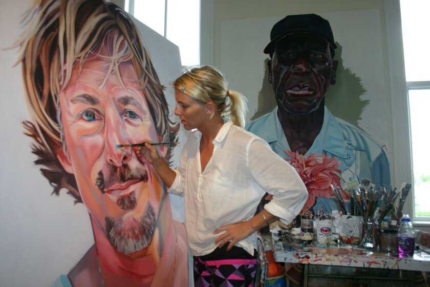 Letty Nowak paints large portraits for her two series, 'The Faces of Surfing' and 'The Faces of Key West.' Courtesy