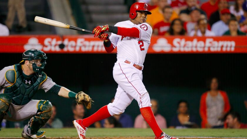 Erick Aybar hits a two-run triple during the fourth inning of a baseball game against the Oakland Athletics, Tuesday, Sept. 29, 2015, in Anaheim, Calif.