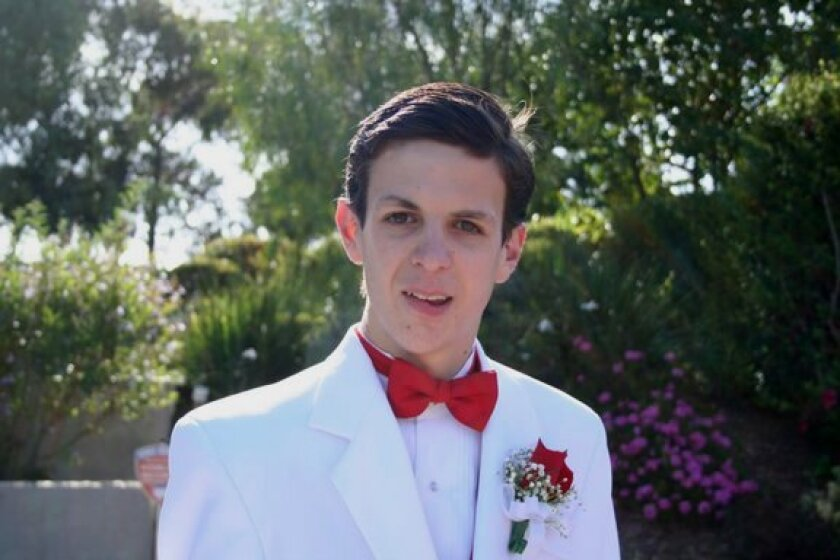 Garrett Baumann — shown on the night of his high-school prom — knew his disease would shorten his life, but he made sure it wouldn't ruin it.