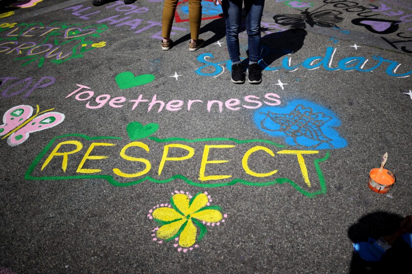 Painted messages on the ground supporting the Asian community