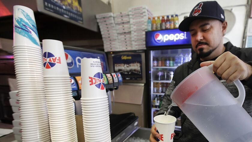 A man fills a disposable cup with water in Berkeley, Calif. on Jan. 23.