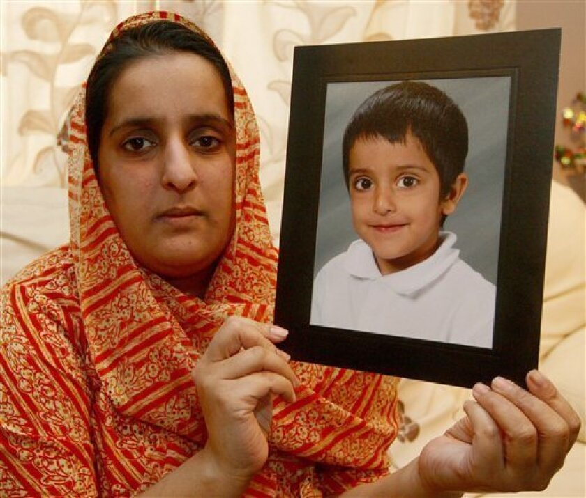 Akila Naqqash holds a picture of her five year old son Sahil, at her home in Oldham, England Thursday March 4, 2010 . Robbers kidnapped Sahil Saeed a 5-year-old British boy from a house in central Pakistan on Thursday and demanded a large ransom for his return, according to British officials and the boy's family. The robbers entered the house late Wednesday night in Jhelum city in Punjab province and terrorized the family for several hours before leaving with the boy, whose father is Pakistani, said George Sherriff, the press attache at the British High Commission in Islamabad. (AP Photo/Dave Thompson, PA,)