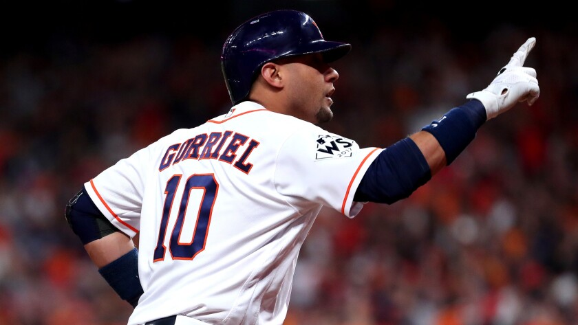 Astros first baseman Yuli Gurriel celebrates after hitting a solo home run against the Dodgers during the second inning of Game 3 on Friday night.