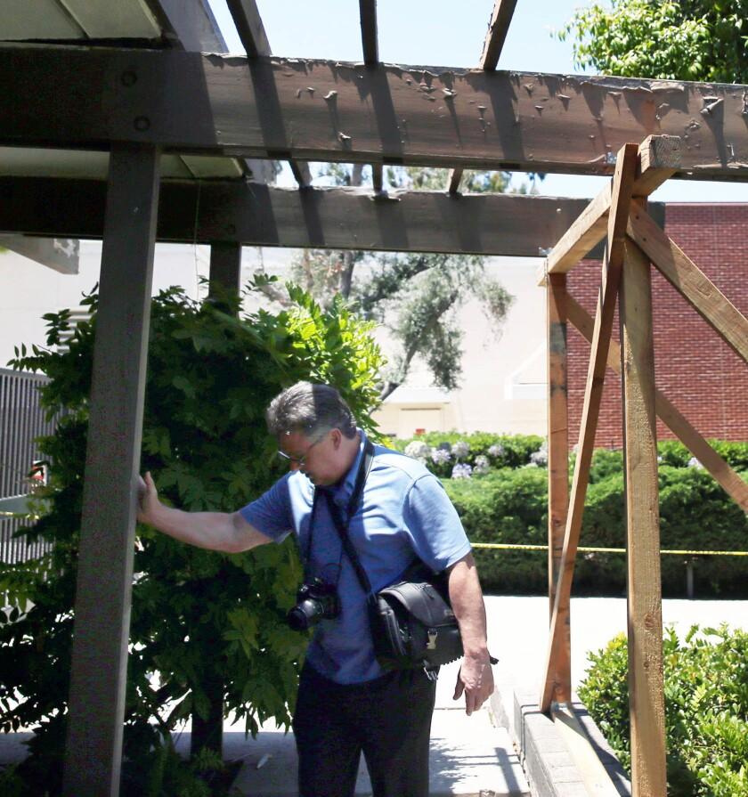 LOS ANGELES, CA-JULY 12, 2019: President at Seneca Structural Engineering, Inc. K. Dirk Bondy checks