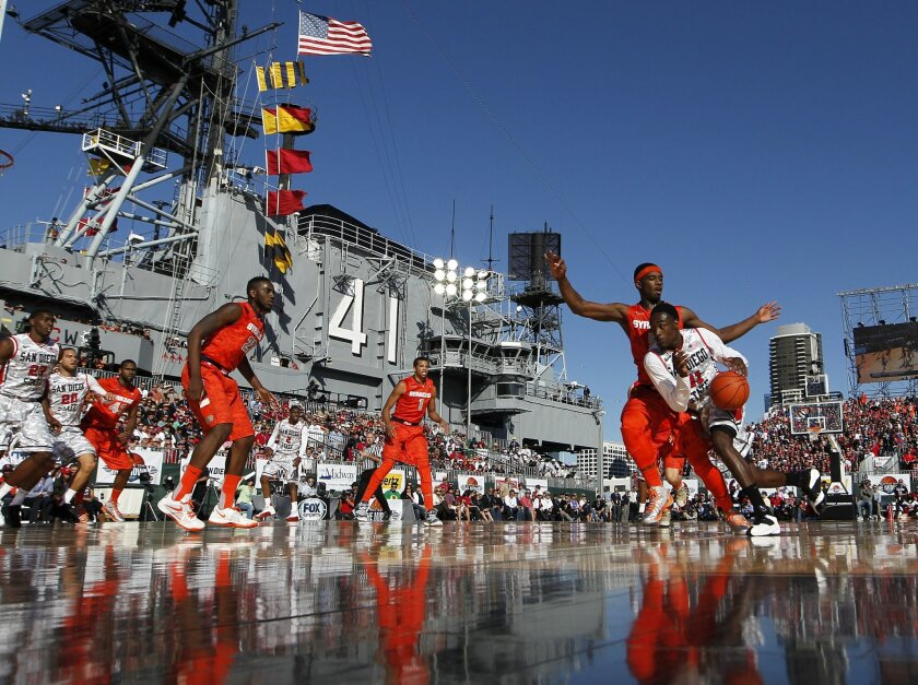 San Diego State's Jamaal Franklin (right) drives toward the basket during a loss to Syracuse on the USS Midway during the Battle on the Midway on Sunday afternoon. Franklin had a team-high 11 points for the Aztecs. Earnie Grafton • U-T