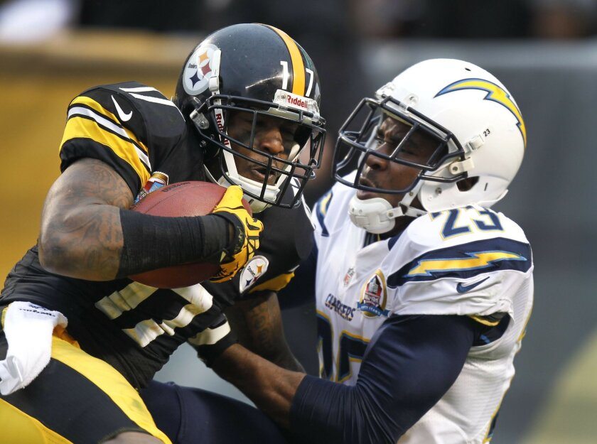 Quentin Jammer tries to stop Mike Wallace from scoring on a third-quarter pass play. Sean M. Haffey • U-T