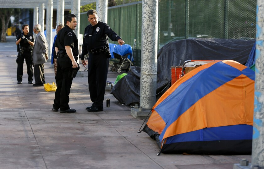 """L.A. County supervisors voted Tuesday to establish a """"sobering center"""" on skid row to serve dangerously intoxicated people, including those living on the streets. Above, a homeless encampment above the 101 Freeway last week."""