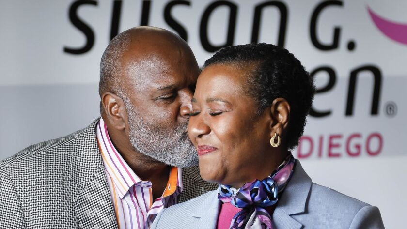 Douglas Gray, left, gives a kiss to his wife, Lilian Vanvieldt-Gray, who is Susan G. Komen San Diego's 2018 Honorary Breast Cancer Survivor. She has been an advocate to encourage black women to get mammograms and he was a leading Race for the Cure fundraiser in 2017.