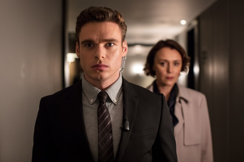 "(L-R) - Richard Maddenand Keeley Hawes in a scene from ""Bodyguard."" Credit: Sophie Mutevelian/World"