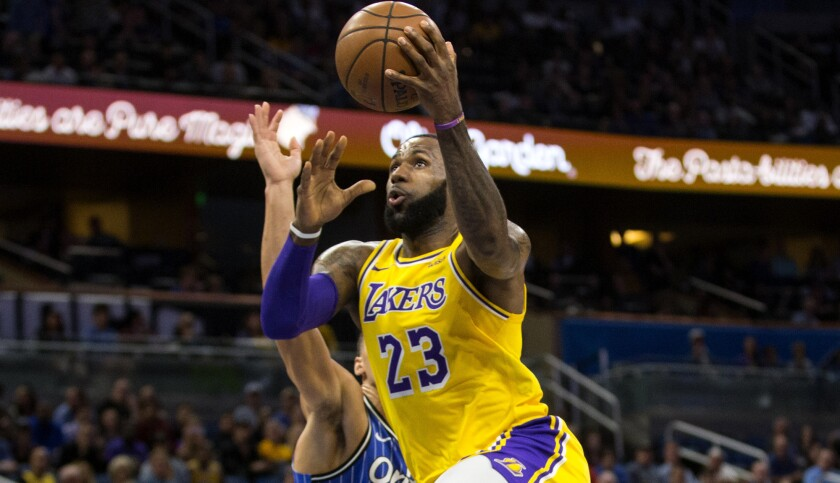 LeBron James scores 22 points against Aaron Gordon and the Magic, but the Lakers' four-game win streak is snapped.