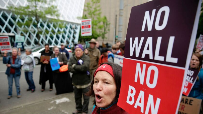 Irene Danysh of Burien, Wash., joins a Seattle protest May 15 against President Trump's travel ban as the 9th U.S. Circuit Court of Appeals prepared to hear arguments in another appeal.